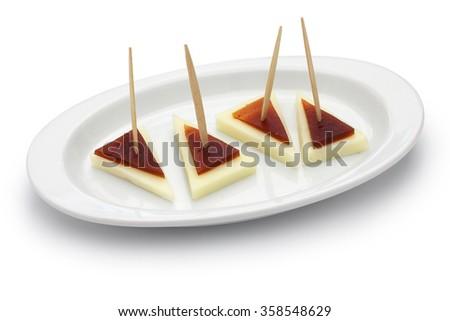 spanish tapas pinchos, machego cheese and membrillo - stock photo
