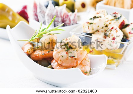 Spanish Tapas with seafood and pickled feta - stock photo