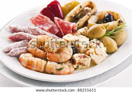 spanish tapas with seafood and sausages - stock photo