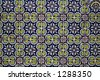 Spanish tile on a wall - stock photo