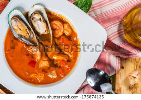 Spanish tomato soup with shellfish, shrimps and other seafood - stock photo