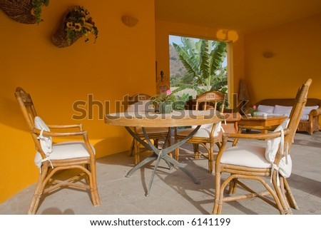 spanish village outdoor terrace with wooden chairs - stock photo