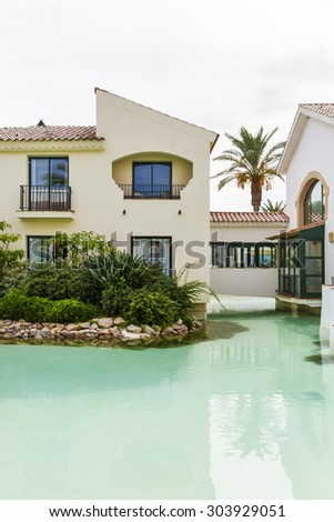 Spanish villas with swimming pool - stock photo