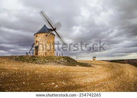 spanish windmills, drammatic sky - stock photo