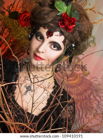 Spanish woman. Young woman in black with artistic visage and with rose in her hair - stock photo