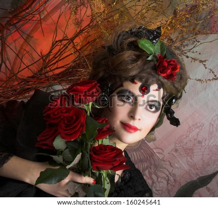 Spanish woman. Young woman in dramatic artistic image with rose's and skull - stock photo