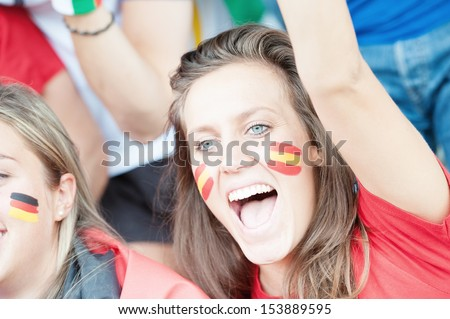 Spanish young supporter at the stadium during the match - stock photo