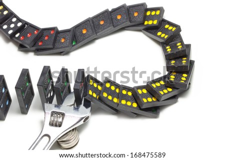 Spanner tool adjusting to stop falling down dominoes in row effect isolated on white as an abstract management concept  - stock photo