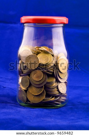 Spare, euro coins in jar - stock photo