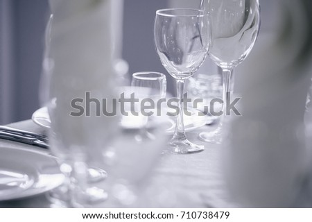 spare glasses and dishes at the restaurant ready for the dinner