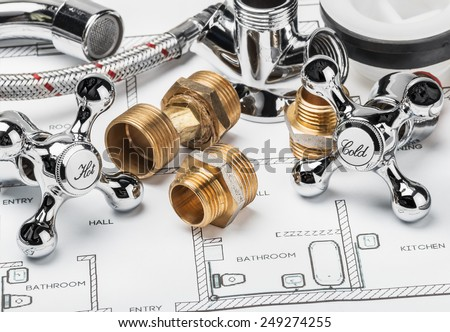 spare parts and tools lying on drawing for repair plumbing - stock photo
