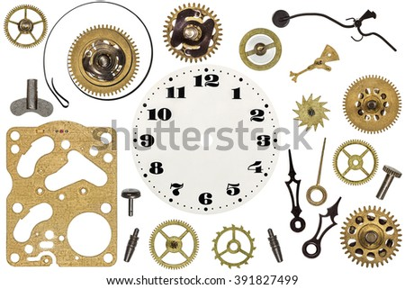 Spare parts for clock. Metal gears, cogwheels, clock face and other details - stock photo