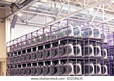 spare parts in a car factory - stock photo