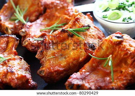 Spare ribs with sour cream - stock photo