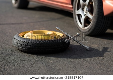 Spare wheel of a car - stock photo