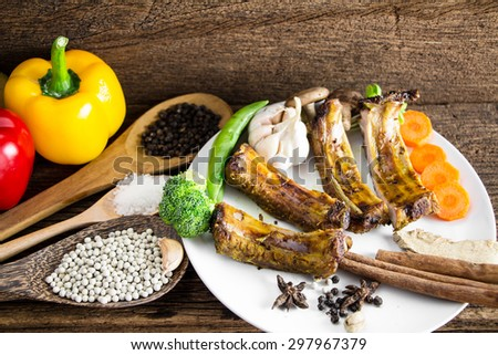 Spareribs on the old wood background - stock photo