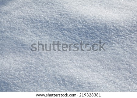 sparkle snowed up field at sunny day background  - stock photo
