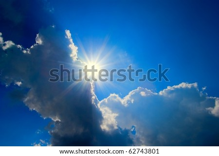 sparkle sun in a dense clouds - stock photo