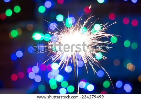 sparkler and beautiful New Year and Christmas bokeh - stock photo