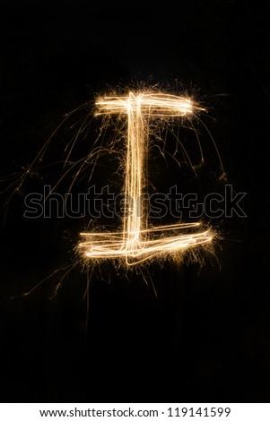 sparkler firework light alphabet - stock photo