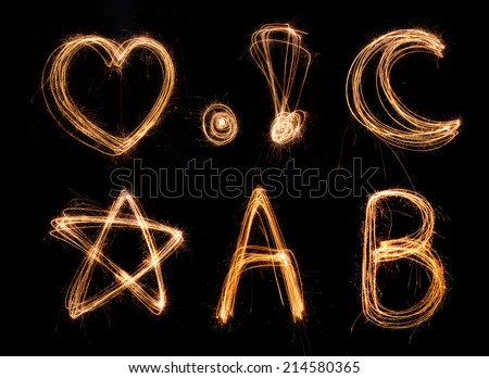 sparkler firework light alphabet A-B - stock photo