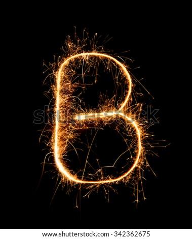 Sparkler firework light alphabet B (Capital Letters) at night background - stock photo