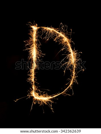 Sparkler firework light alphabet D (Capital Letters) at night background - stock photo