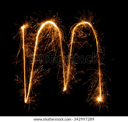 Sparkler firework light alphabet m (Small Letters) at night background - stock photo