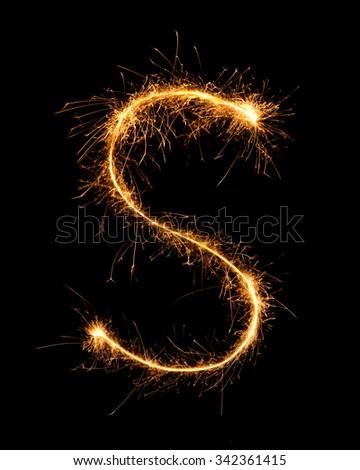 Sparkler firework light alphabet S at night background - stock photo