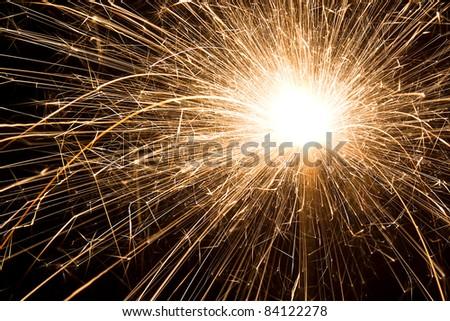 Sparkler Fireworks illuminate the darkness - stock photo