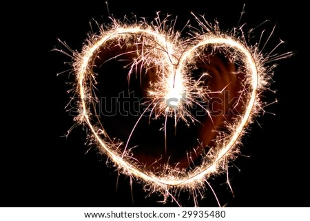 Sparkler in Heart Shape - stock photo