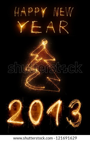 Sparkler new year background in brown - stock photo
