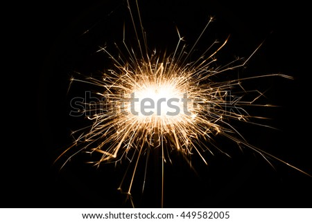 Sparkler on black background for Christmas or new year party, close-up - stock photo