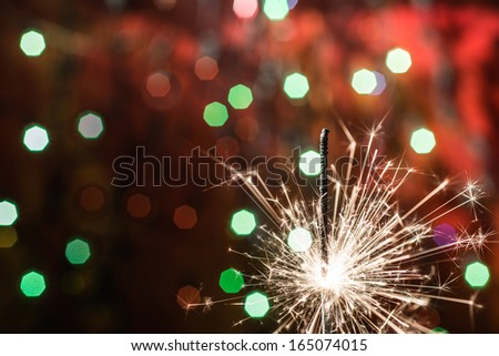 sparkler on bokeh background - stock photo