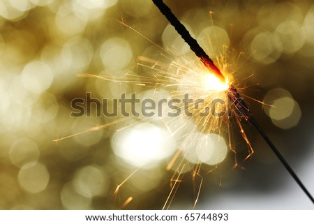 sparkler on gold - stock photo