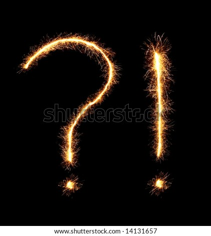 sparklers forming a question and exclamation mark (see more letters in my portfolio) - stock photo