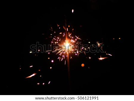 Sparklers on a black background. Shallow depth of field