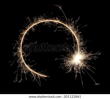 sparklers sparks on a black background - stock photo