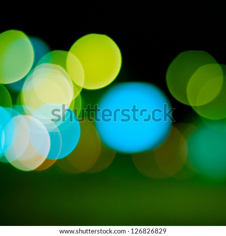 sparkling and defocused lights background. green bokeh background. abstract blurred lights - stock photo