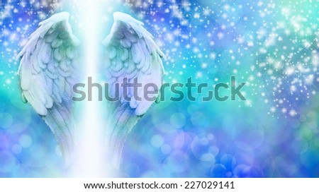 Sparkling Angel Wings Banner - blue bokeh background with a rainfall of sparkles falling from top to bottom and a large pair of Angel Wings on the left side with a shaft of bright light between - stock photo