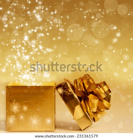 Sparkling Christmas background with gift box - stock photo