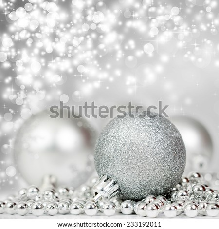Sparkling Christmas background with silver Christmas decorations - stock photo