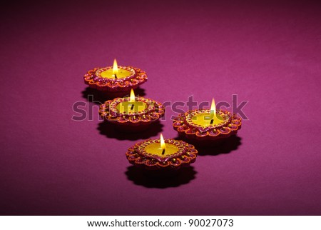 Sparkling Diwali Lamps Background, Beautifully Lit Lamps for the Hindu Diwali festival - stock photo