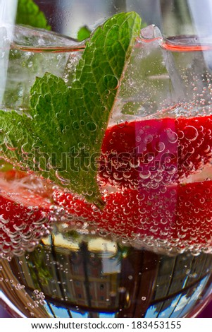 sparkling drink with strawberries and mint - stock photo