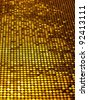 Sparkling, metallic, golden, sequined textile for disco, party or fashion designs. - stock photo