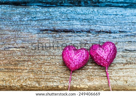 Sparkling pink hearts on gradient wooden background for Valentines Day - stock photo