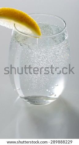 Sparkling water in  glass with lemon