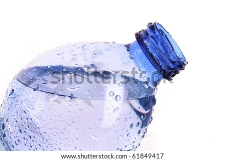 Sparkling water with drops isolated on white - stock photo