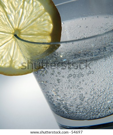 sparkling water with lemon - stock photo
