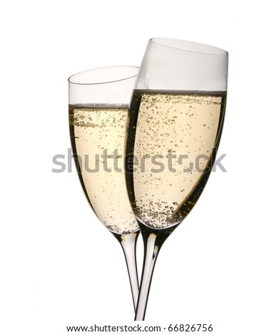 Sparkling wine in two glasses clinked in toast to celebrate event. Isolated on white. - stock photo